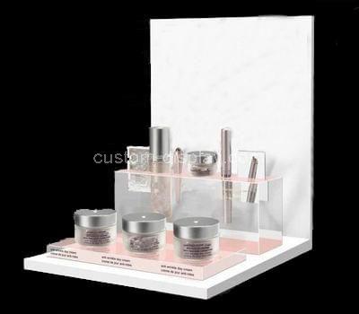 white acrylic cosmetic retail displays