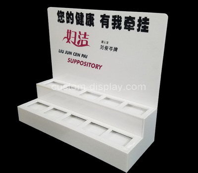 white acrylic retail display