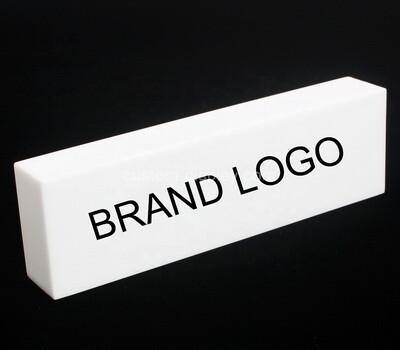 Custom black acrylic brand sign block