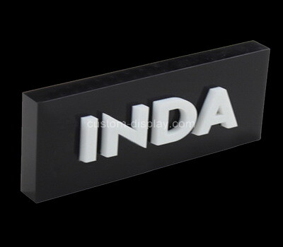 Custom black acrylic brand block