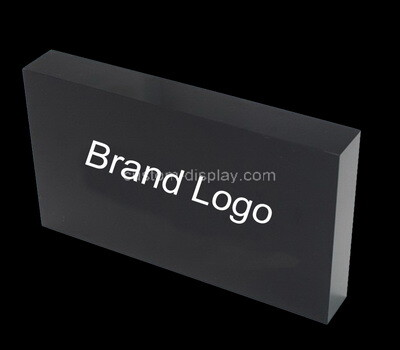 Custom black lucite brand block