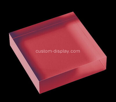 Laser cutting red acrylic block