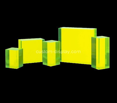 Laser cutting neon yellow acrylic blocks